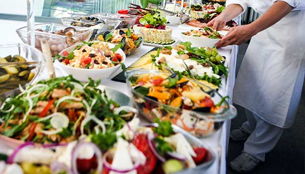 corporate catering with large healthy buffet spread of mediterranean food