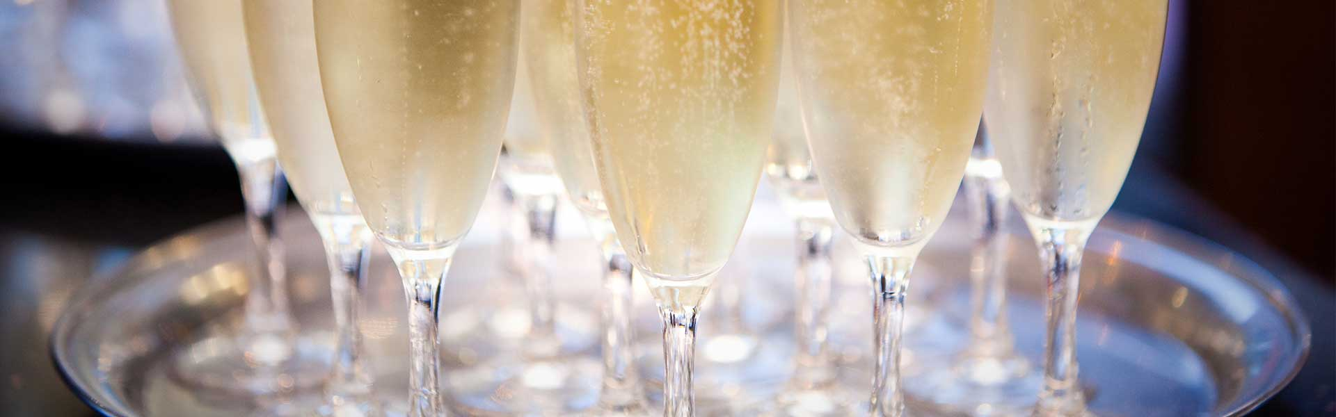 https://thefrenchgourmet.com/wp-content/uploads/2018/02/catering-serving-chilled-champagne-glasses.jpg