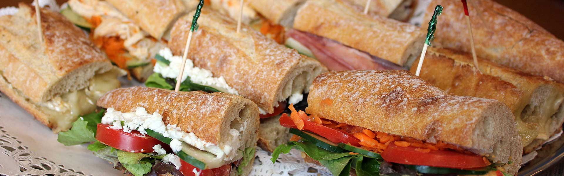 https://thefrenchgourmet.com/wp-content/uploads/2018/02/takeout-catering-baguette-sandwiches.jpg